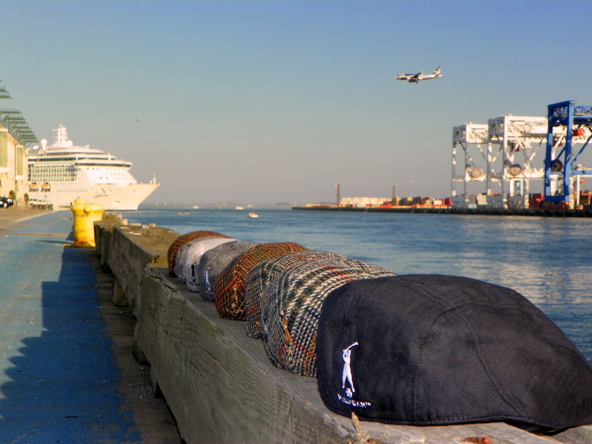 back side of hats with cruise ship and jet 2